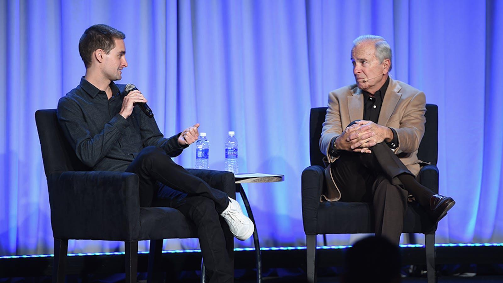 Snapchat CEO Evan Spiegel speaks to journalist Ken Auletta. Photo by Larry Busacca/Getty Image.