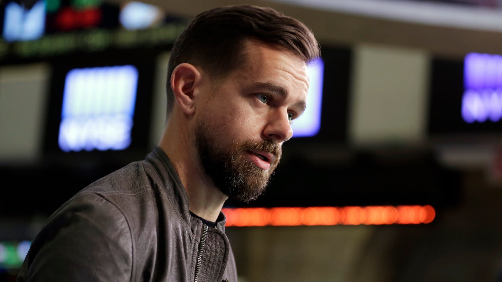Twitter CEO Jack Dorsey. Photo by AP. Screen shot of Huffington Post's Twitter profile page.