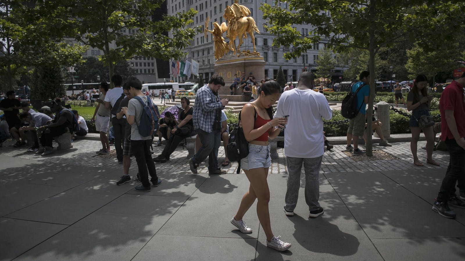People playing Pokemon Go in New York City this week. Photo by Bloomberg.