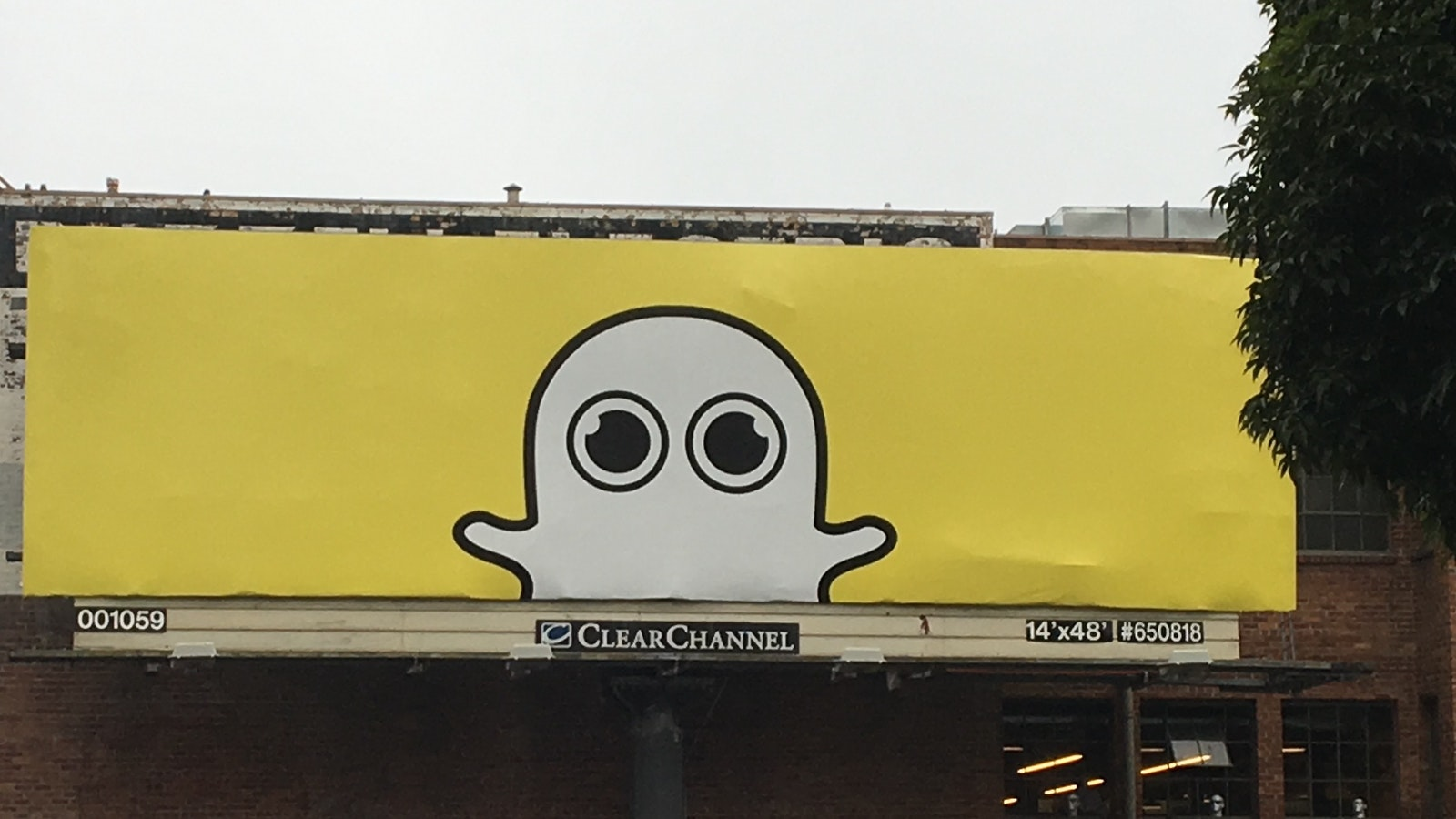 A billboard in San Francisco displaying an updated version of Snapchat's Ghost logo to include the Spectacles. Photo by Tom Dotan.