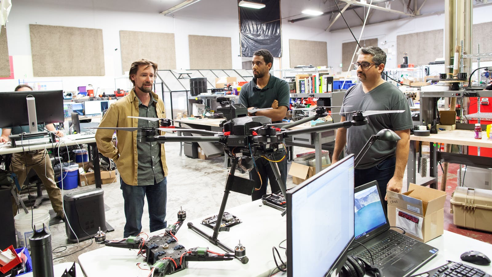 "Airspace co-founders Earl Stirling, Noah Moore and Jaz Banga with the company's ""Interceptor"" drone-catcher. Photo by Reed Albergotti. Video by Airspace."