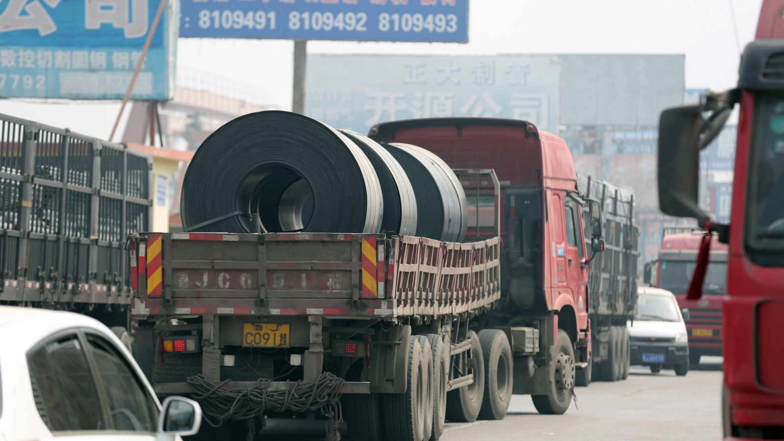 A truck carrying steel in China. Photo by AP.