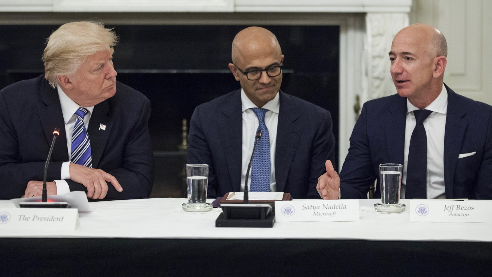 President Trump with Microsoft CEO Satya Nadella and Amazon CEO Jeff Bezos at a White House meeting in June. Photo by Bloomberg.