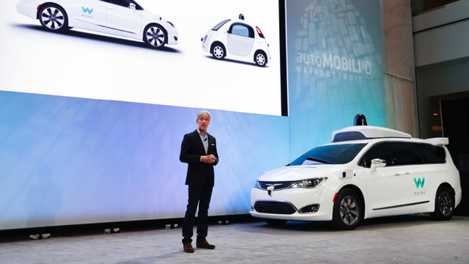 Waymo CEO John Krafcik unveiling the Chrysler Pacifica outfitted with Waymo technology at the auto show in Detroit in January. Photo by AP.