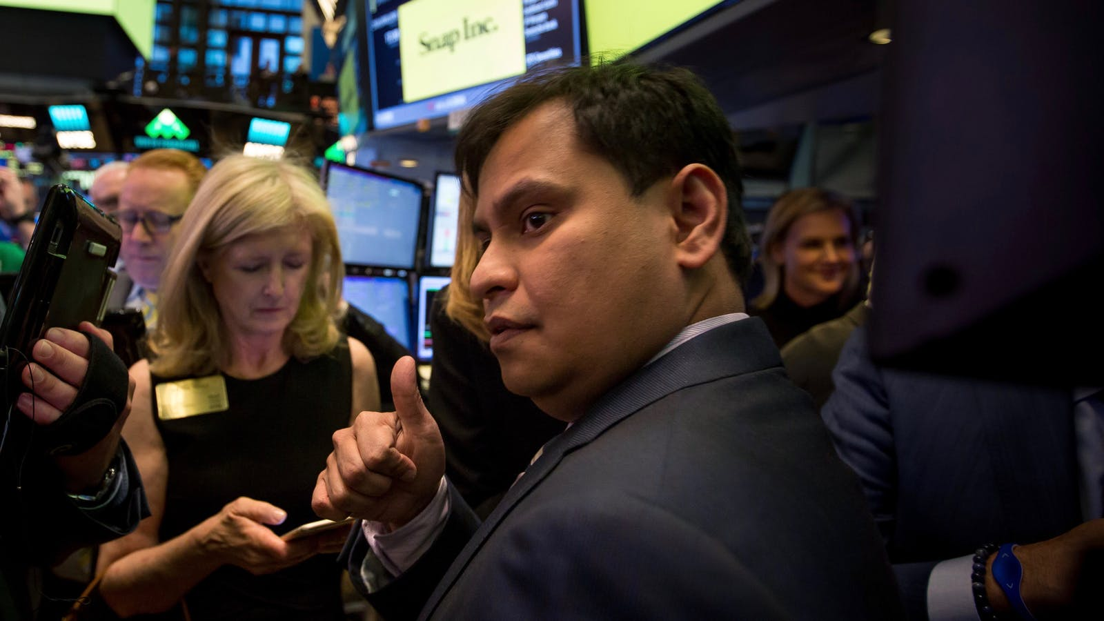 Snap Chief Strategy Officer Imran Khan on the floor of the New York Stock Exchange when  Snap went public in March. Photo by Bloomberg.