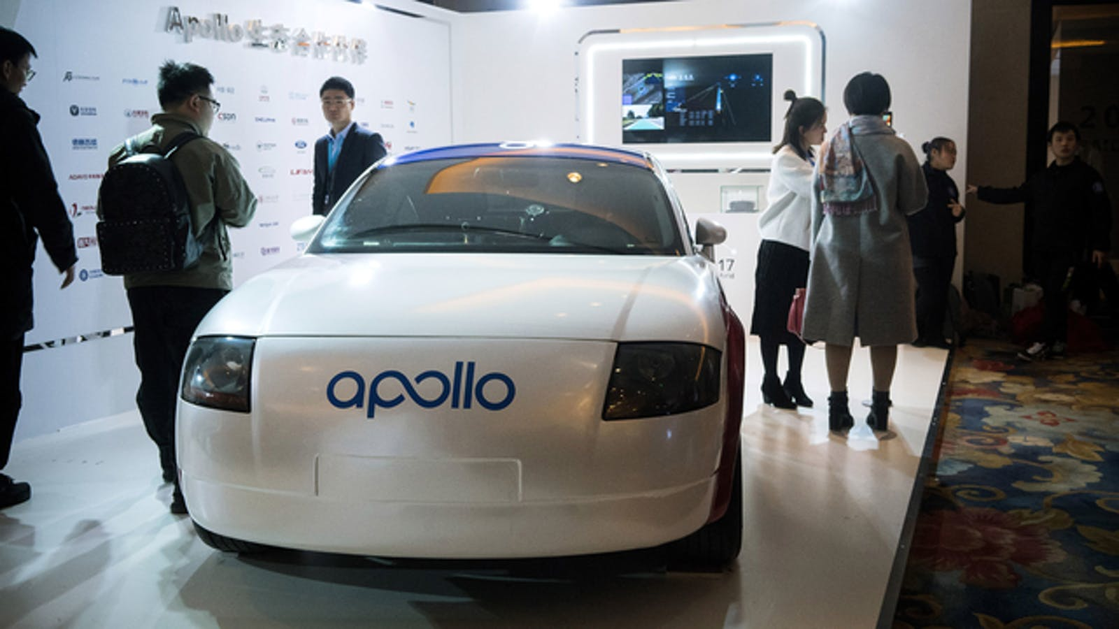 The branding for Baidu's Apollo self-driving car system is displayed on a car at the Baidu World Technology Conference in Beijing, China. Photo by Bloomberg.