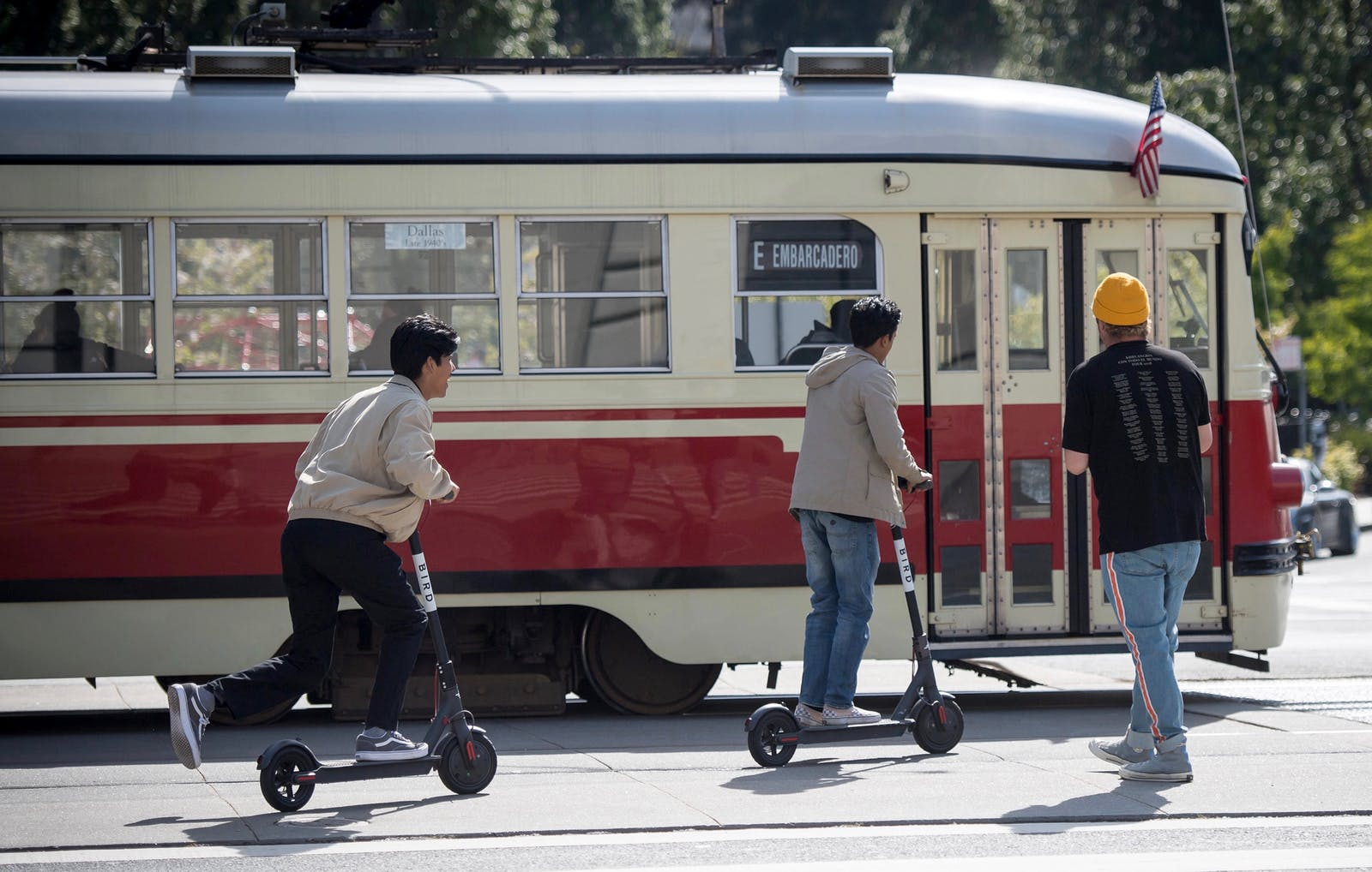 People riding scooters in downtown San Francisco. Photo by Bloomberg