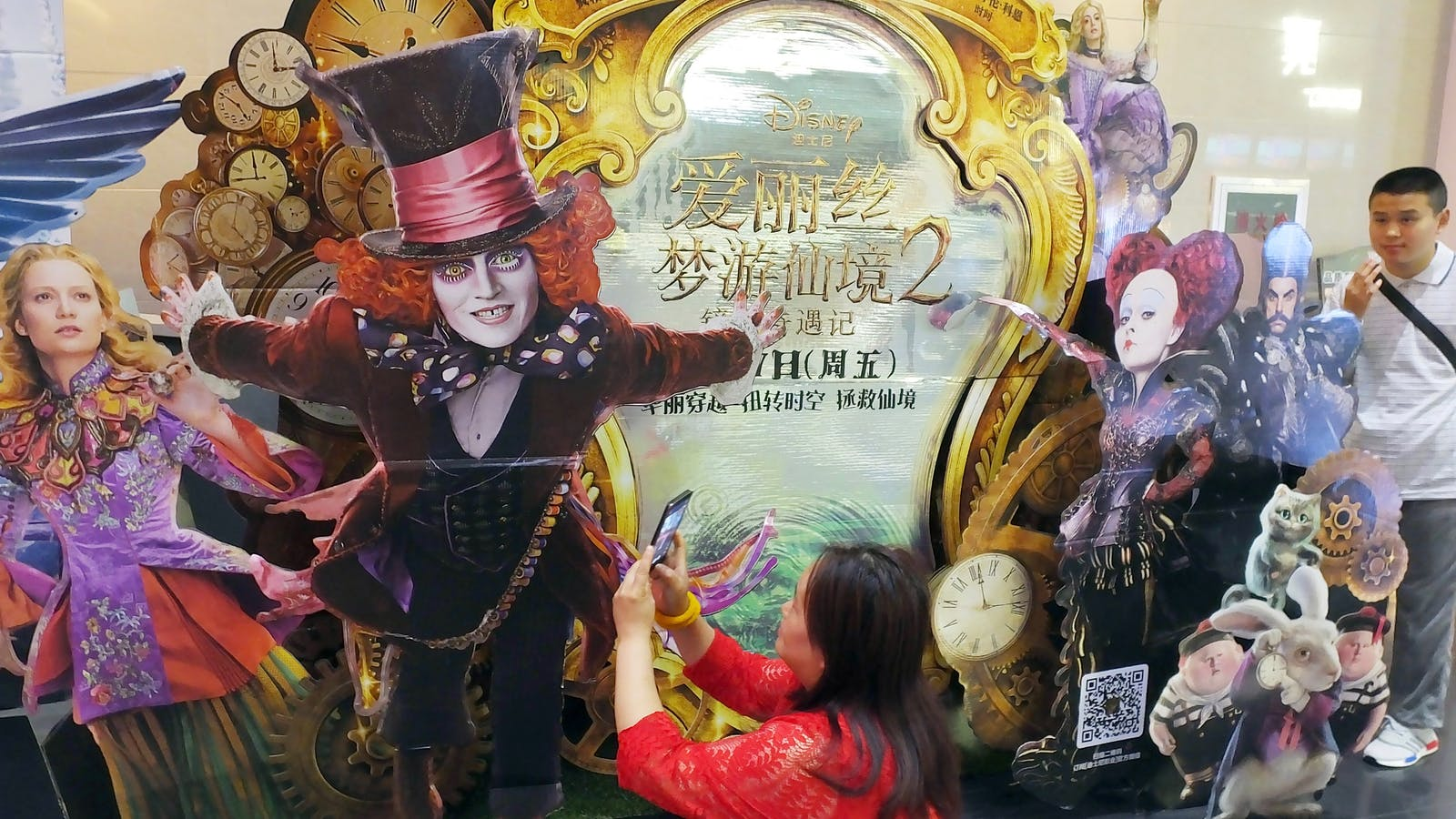 """A poster for the Disney movie """"Alice Through the Looking Glass"""" at a movie theater in Yichang in China in 2016. Photo by AP."""