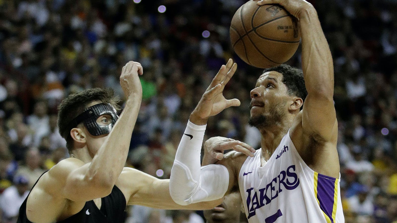 Los Angeles Lakers' Josh Hart and Portland Trail Blazers' Zach Collins during an NBA game earlier this month. Photo by AP