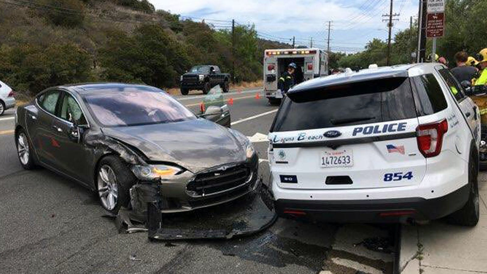 A Tesla sedan, left, in autopilot mode that crashed into a parked police cruiser in Laguna Beach, Calif., in May. Photo: AP
