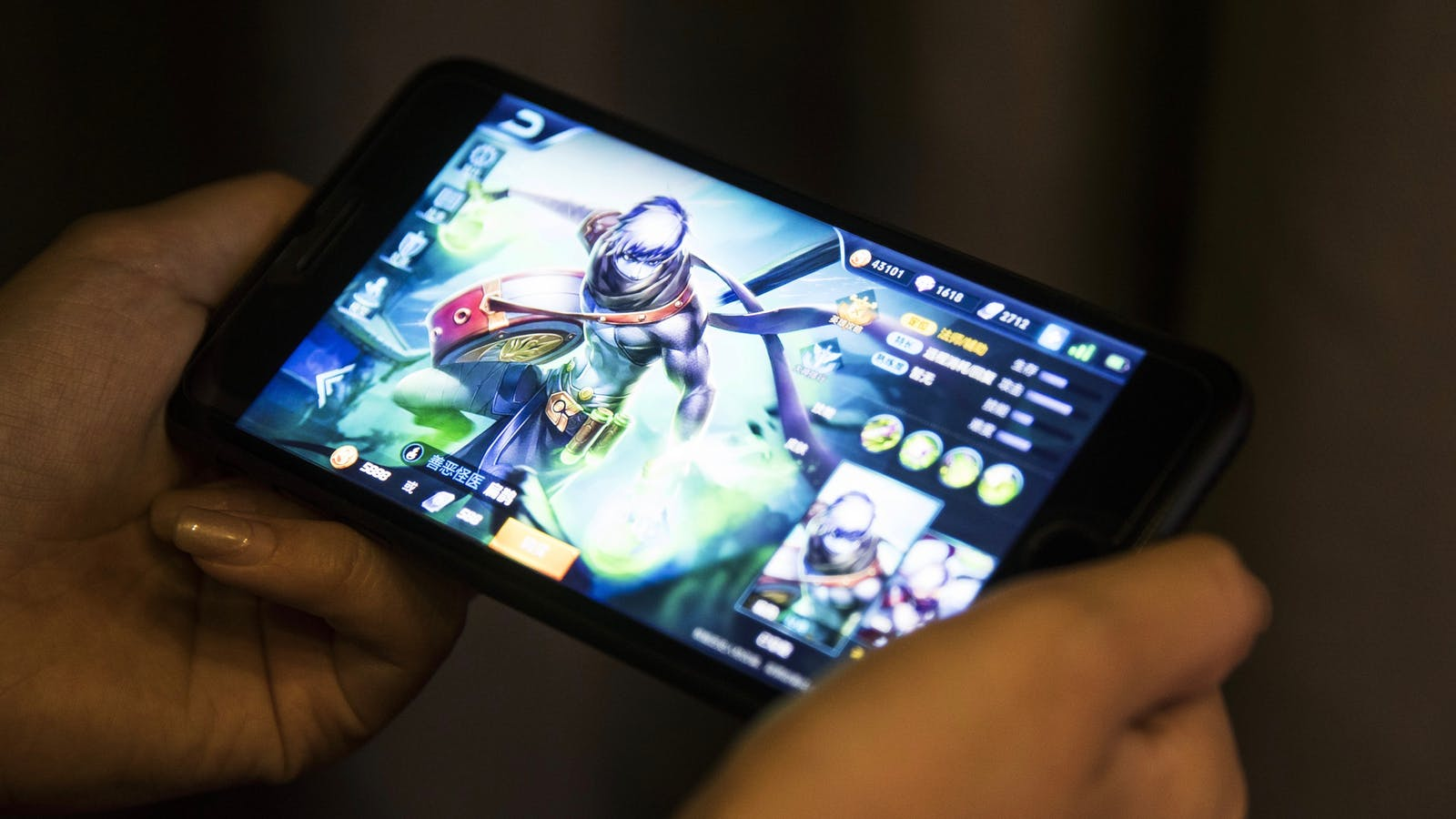 Tencent's Honor of Kings mobile game on an iPhone in Hong Kong last year. Photo by Bloomberg