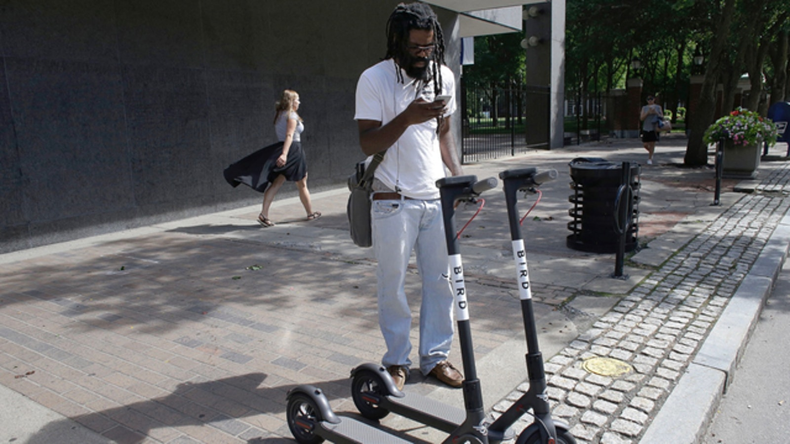 A man prepared to ride a Bird scooter in Providence, R.I., in July. Photo: AP