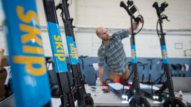 A technician worked on a Skip scooter at the company's repair shop in San Francisco. Photo: Bloomberg