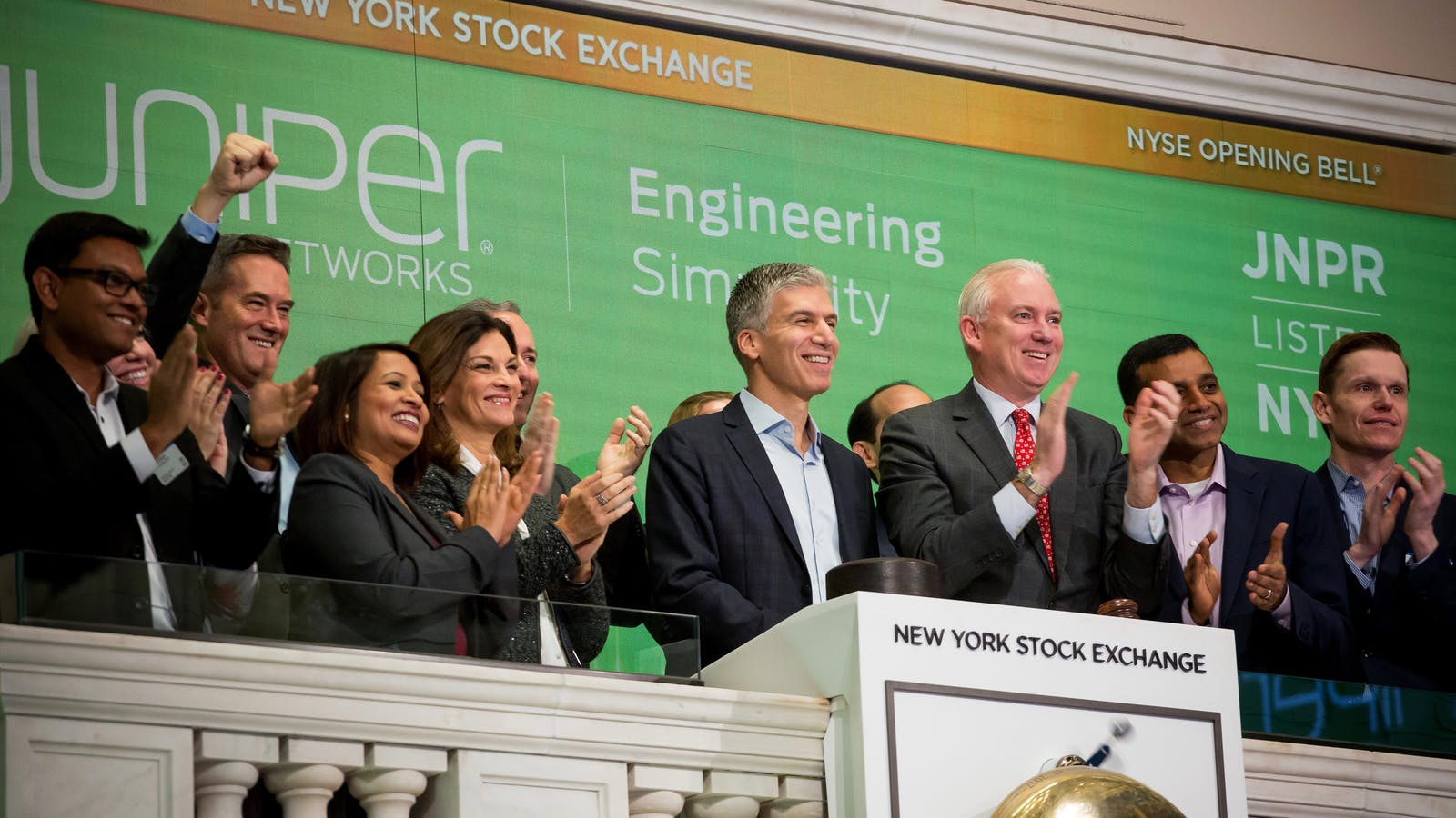 Juniper CEO Rami Rahim, center, at the New York Stock Exchange last month. Photo by Bloomberg