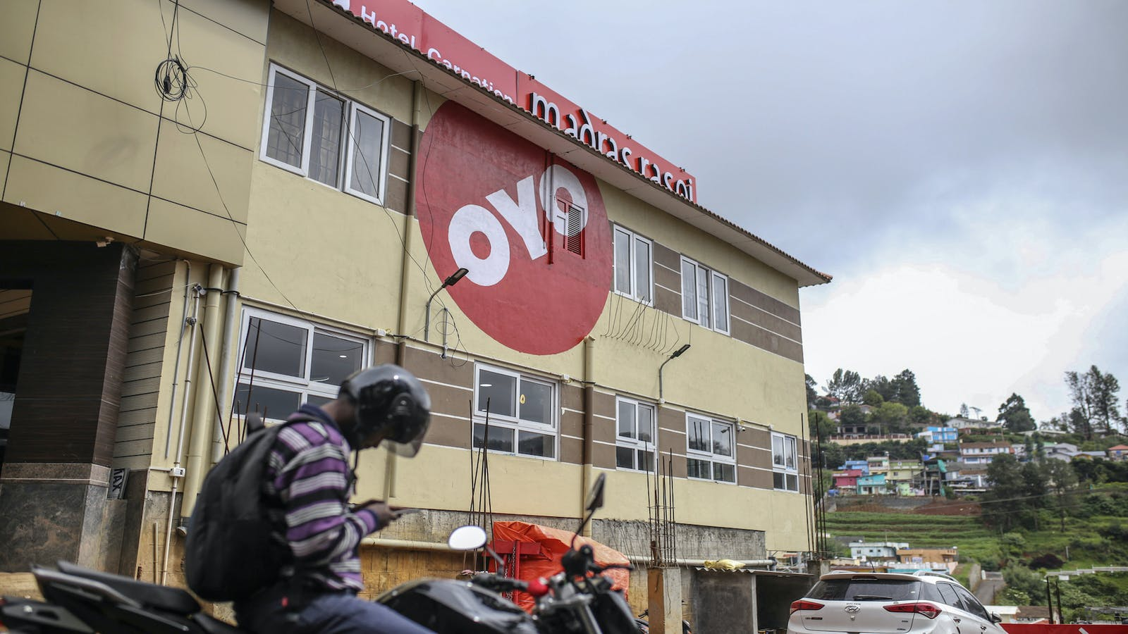 The logo of OYO Rooms is displayed on a hotel in Tamil Nadu, India. Photo by Bloomberg.