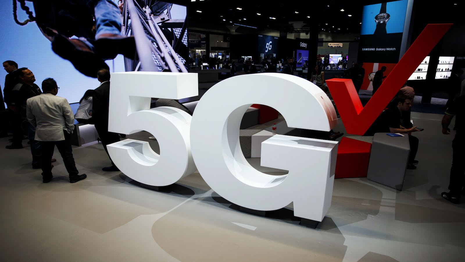 A 5G sign at a Verizon company booth during a 2018 telecoms industry conference in Los Angeles. Photo by Bloomberg.