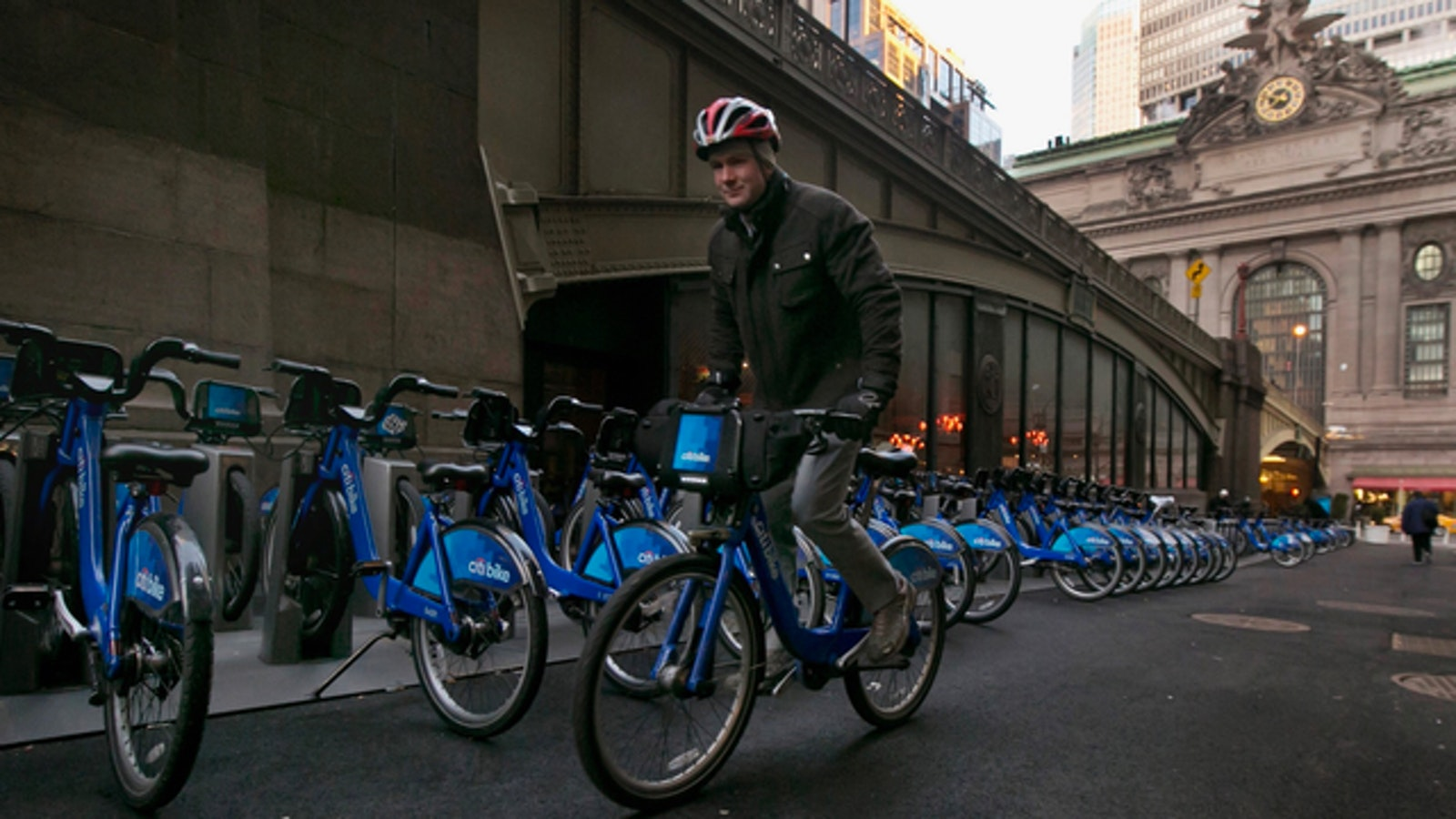 A man rode a Citi Bike, which is now owned by Lyft, near New York City's Grand Central Terminal in early 2015. Photo: AP