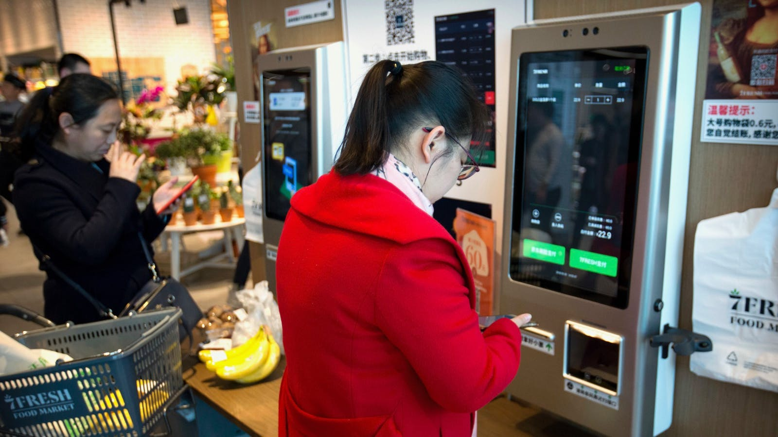 Customers in Beijing used JDPay electronic payment apps on their smartphones last year to pay at a 7FRESH grocery store operated by JD.com. Photo: AP