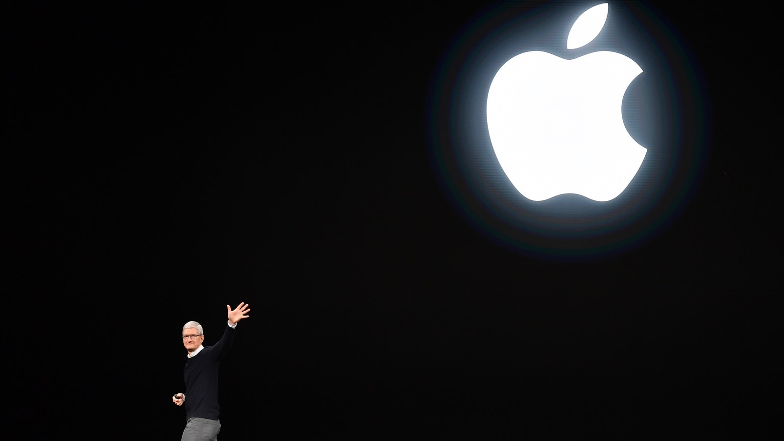 Apple CEO Tim Cook on stage at Apple's news and video presentation last month. Photo by Bloomberg.