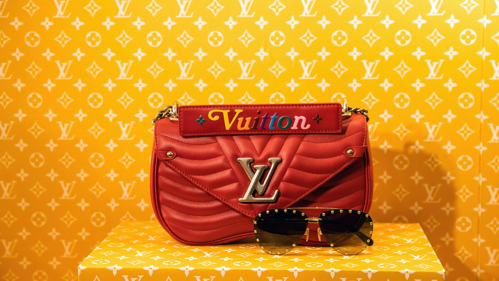 A Louis Vuitton handbag and sunglasses. Photo by Bloomberg
