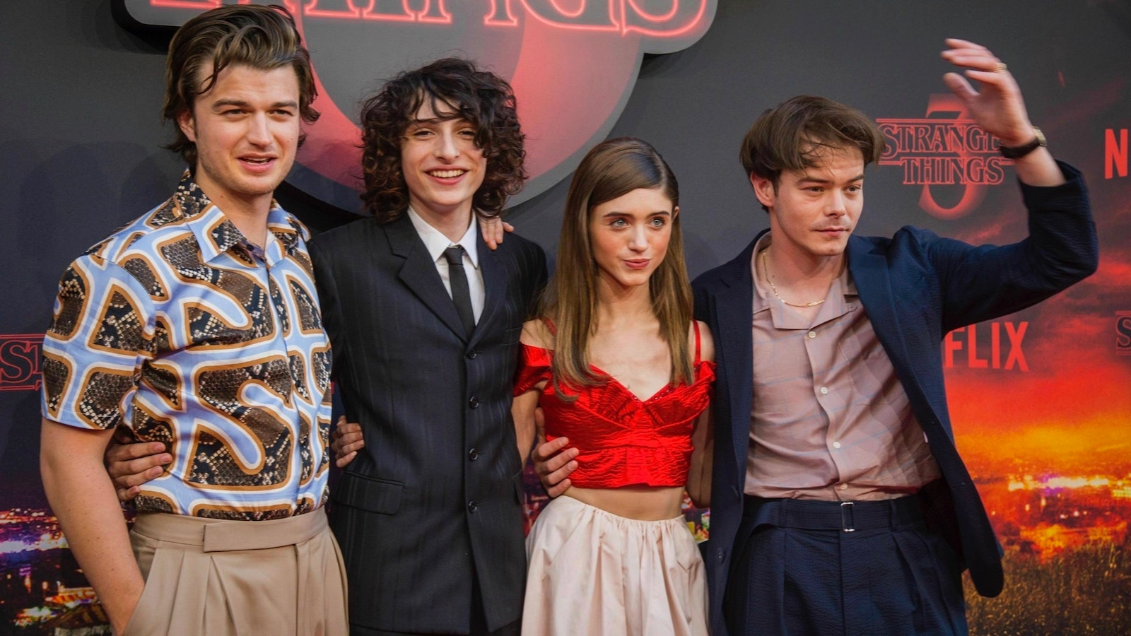 Cast members of Netflix 's Stranger Things at a screening in France last month. Photo by AP.
