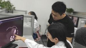 Shukun employees examine a scan. Photo courtesy of Shukun Technology.