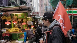 A Klook tour guide on a Klook-hosted walking tour in Hong Kong last year. Photo by Bloomberg