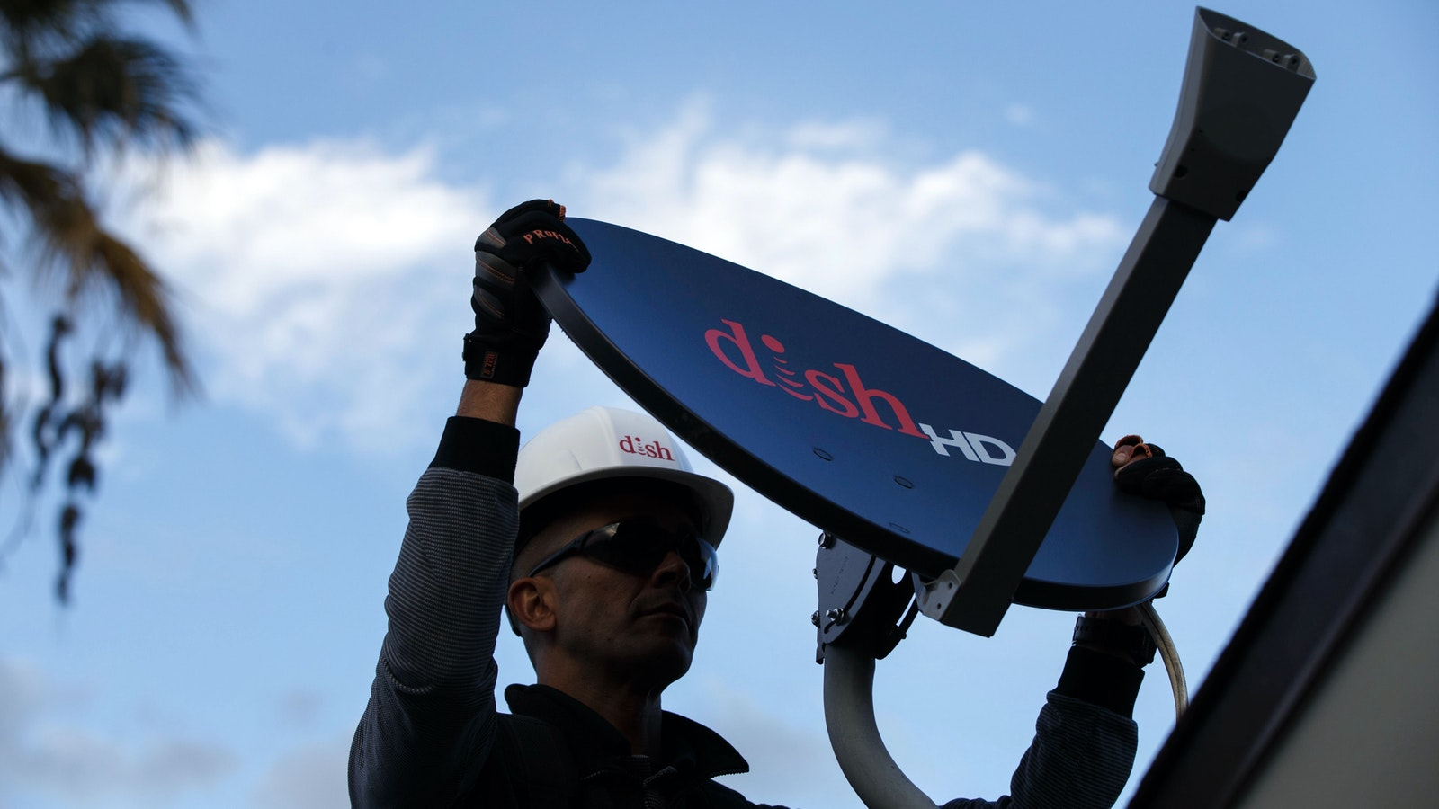 A technician working for Dish Network, which has begun offering marketing and customer support to other TV providers. Photo by Bloomberg
