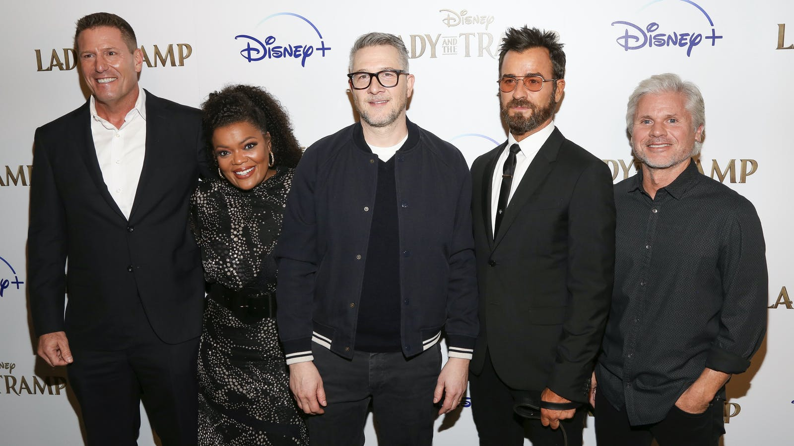 Disney's direct to consumer chief Kevin Mayer, far left, with the cast of Disney's 'Lady and the Tramp' at a screening sponsored by Disney Plus. Photo by AP