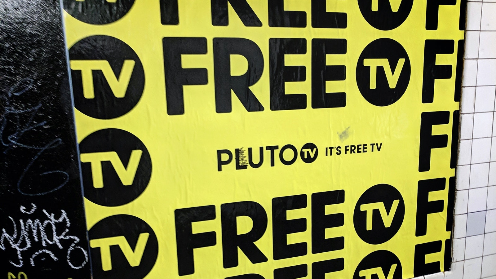 An ad for Viacom's Pluto TV service on a New York subway wall earlier this year. Photo by AP