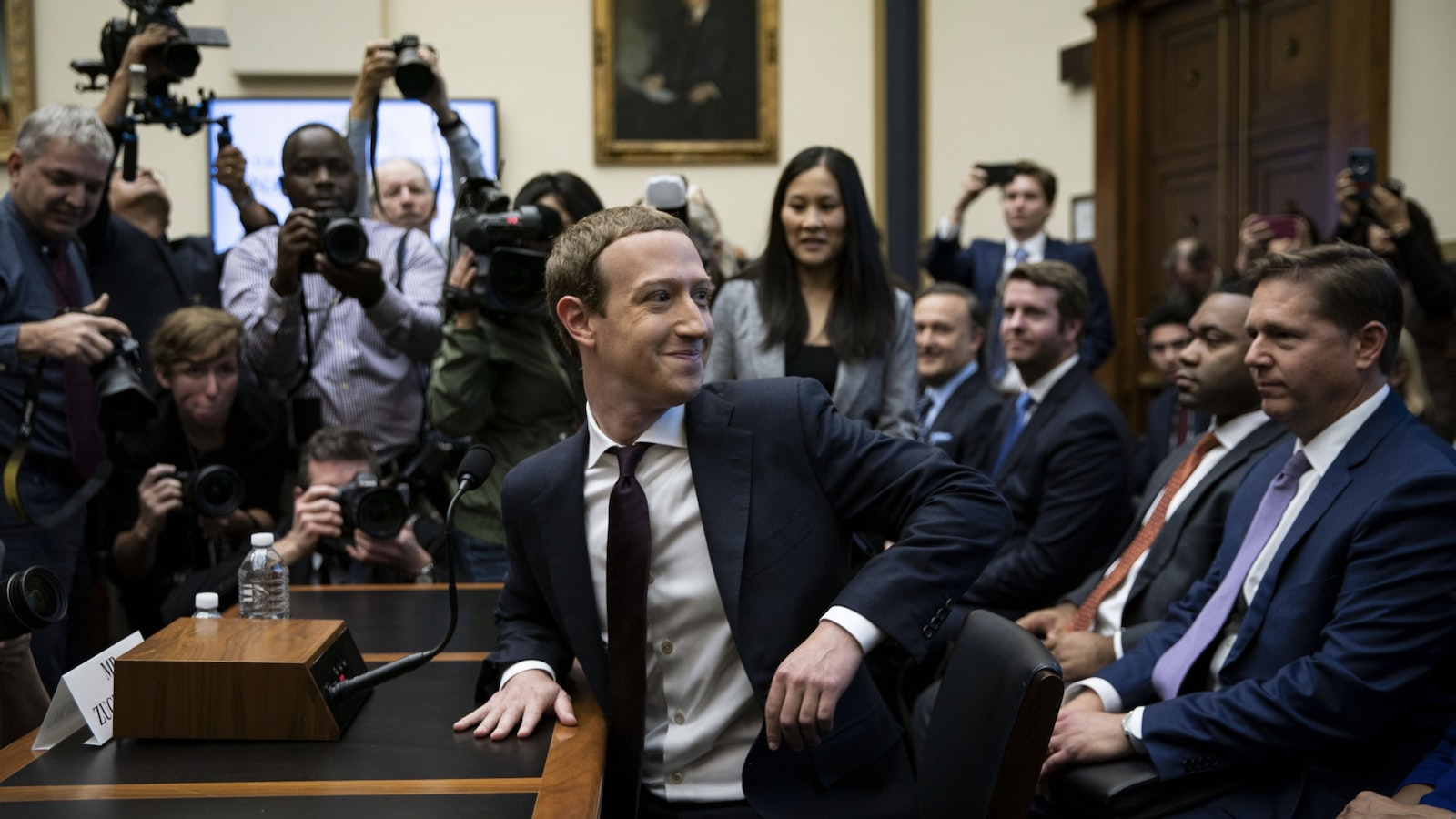 Facebook CEO Mark Zuckerberg at a congressional hearing last year. Facebook's U.S. public policy vice president Kevin Martin is sitting behind him. Photo by Bloomberg