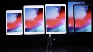 Apple CEO Tim Cook unveiling a new line of iPads last year.  Photo by AP