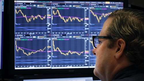 A trader on the floor of the New York Stock Exchange on Tuesday. Photo by AP