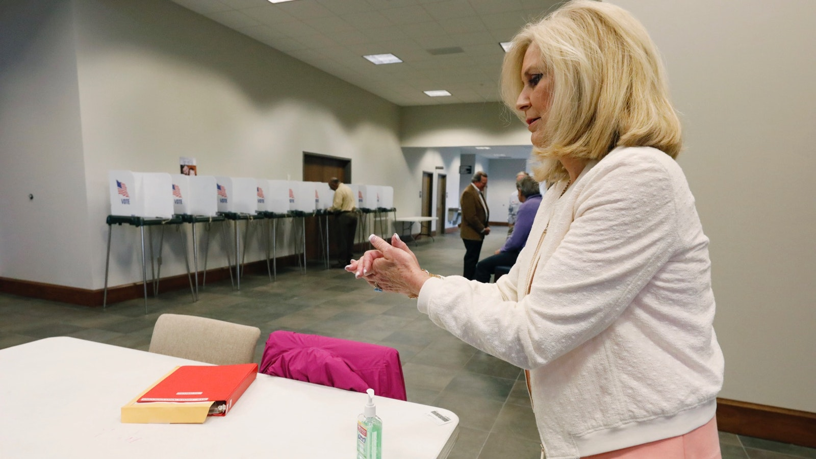 Mississippi Republican Attorney General Lynn Fitch uses hand sanitizer  after voting in the party presidential primary on March 10. Photo: AP