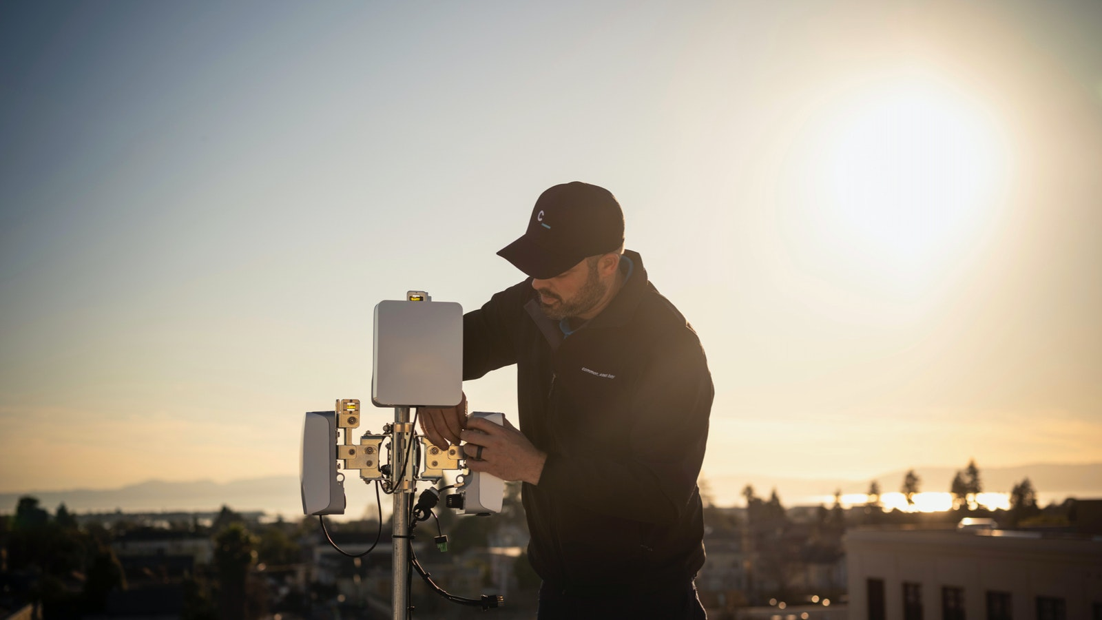 A Common Networks field technician installs a wireless broadband connection. Photo by Common Networks