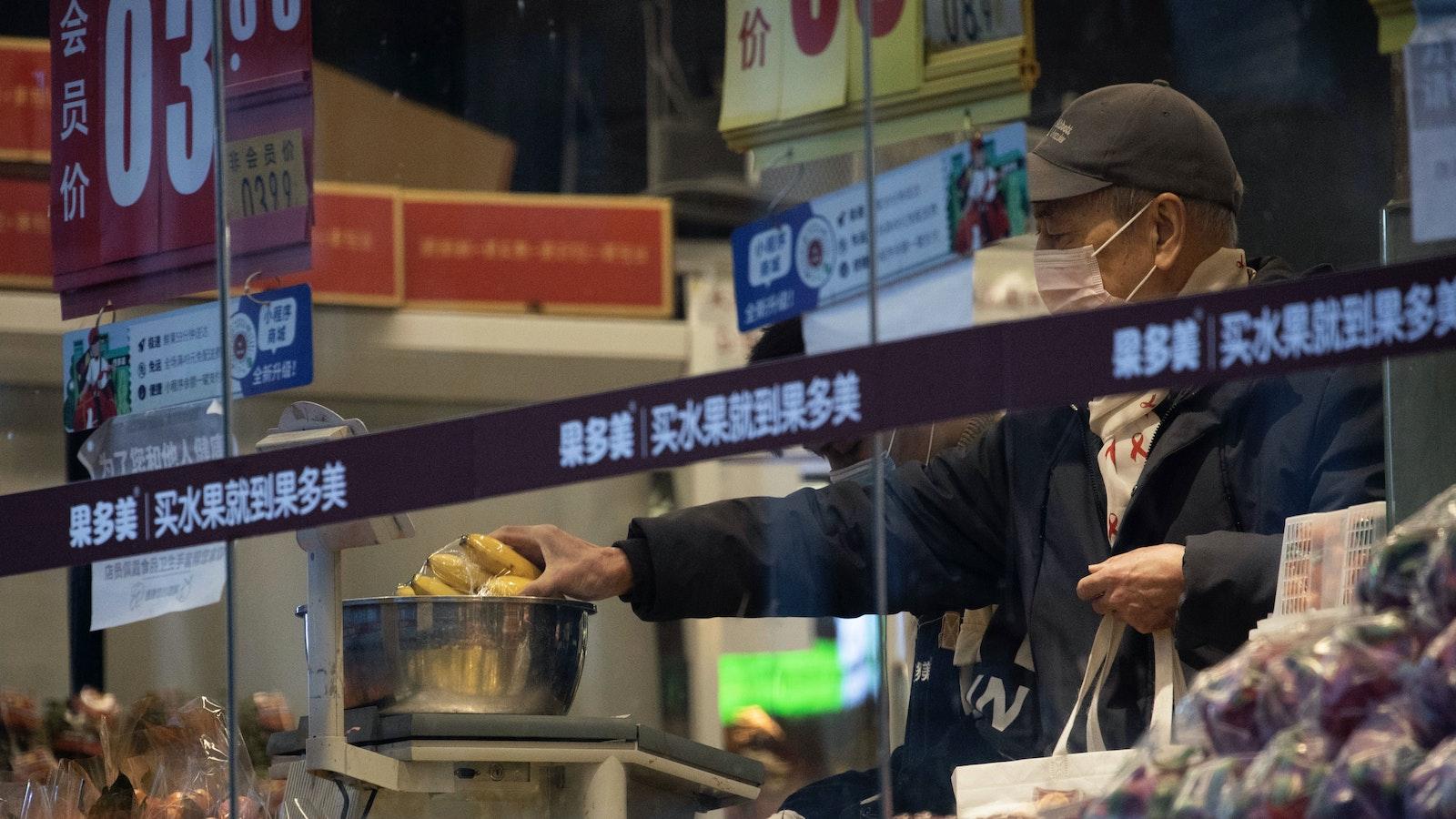 A shopper in Beijing in February. Photo by AP