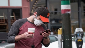 A person wearing a protective mask in San Francisco on May 14, 2020. States are easing some coronavirus restrictions and tech companies are slowly planning a return to work. Photo: Bloomberg