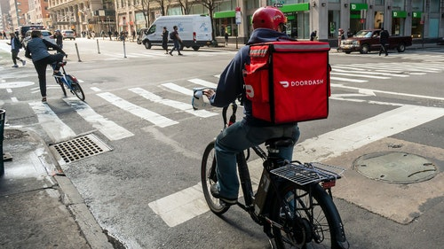 A DoorDash delivery person in New York City in March. Photo by Shutterstock