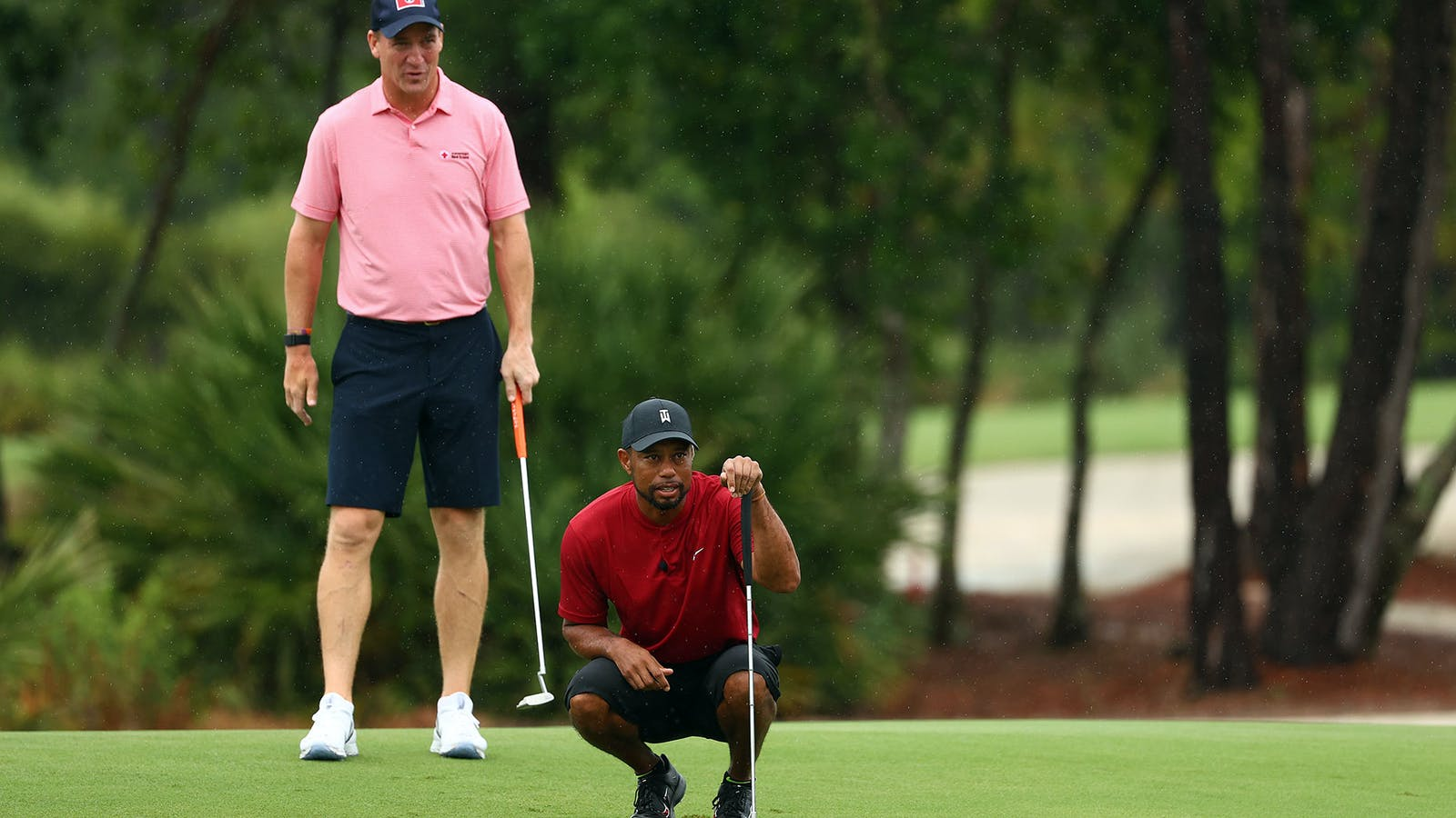 Tiger Woods and Peyton Manning during last month's charity tournament that drew heavy betting. Photo by Getty Images/Mike Ehrmann