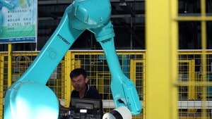 "Testing for Foxconn's industrial robots ""Foxbot"" are performed at Foxconn factory in Longhua town, Shenzhen in 2016. Photo by Getty Images."