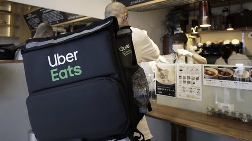 An Uber Eats delivery person in Japan. Photo by Bloomberg.