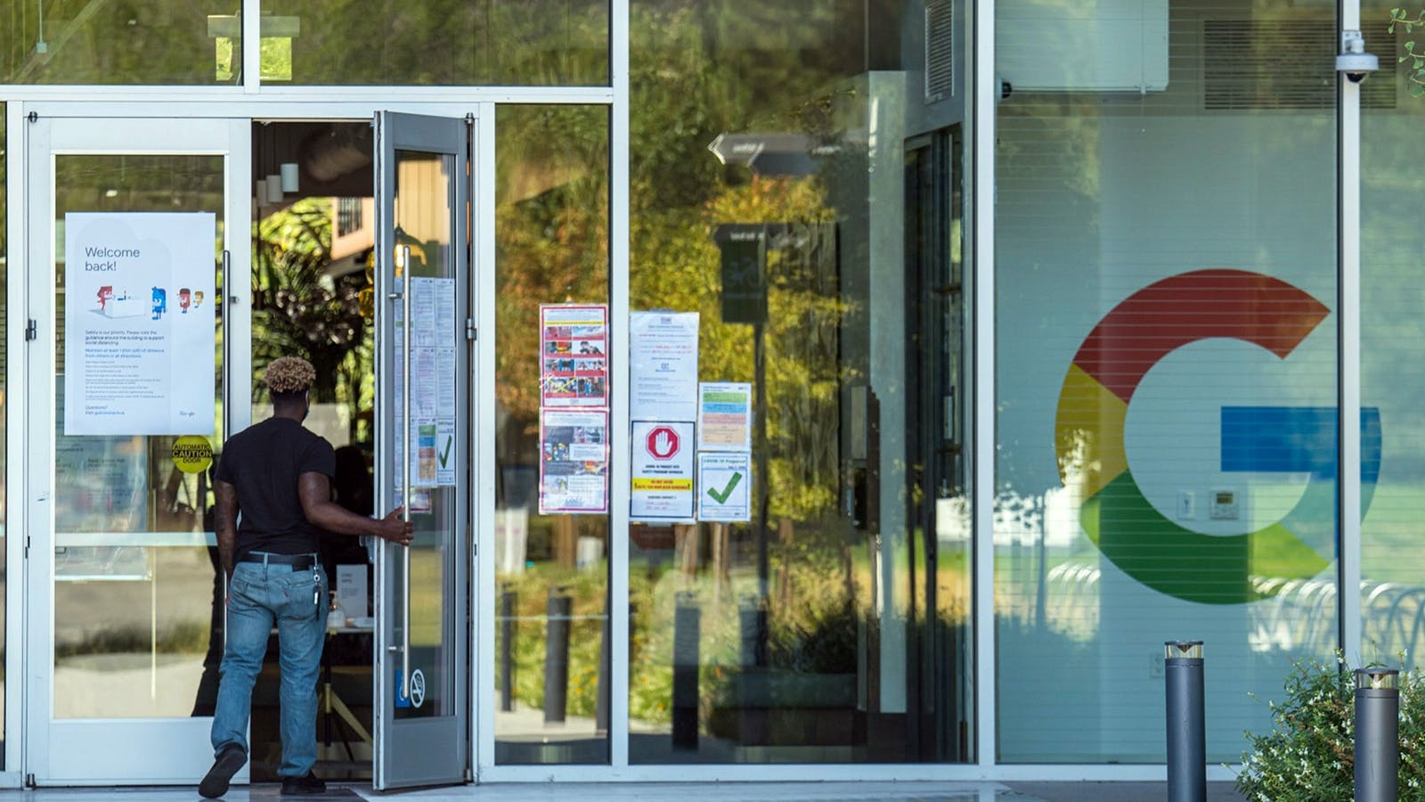 A person walks into a building at the Google campus in Mountain View, California, on Monday, July 27, 2020. Photo by Bloomberg