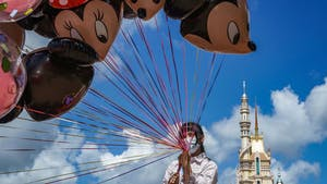 An  employee at Walt Disney Co.'s Disneyland Resort in Hong Kong on June 18. Shutdowns resulting from the coronavirus contributed to a $4.7 billion quarterly loss.