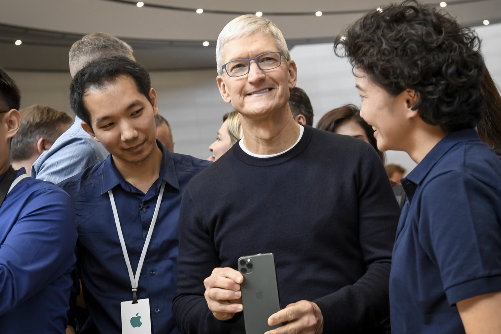 Apple CEO Tim Cook holds the iPhone 11 Pro after an event unveiling it last September. Photo by Bloomberg