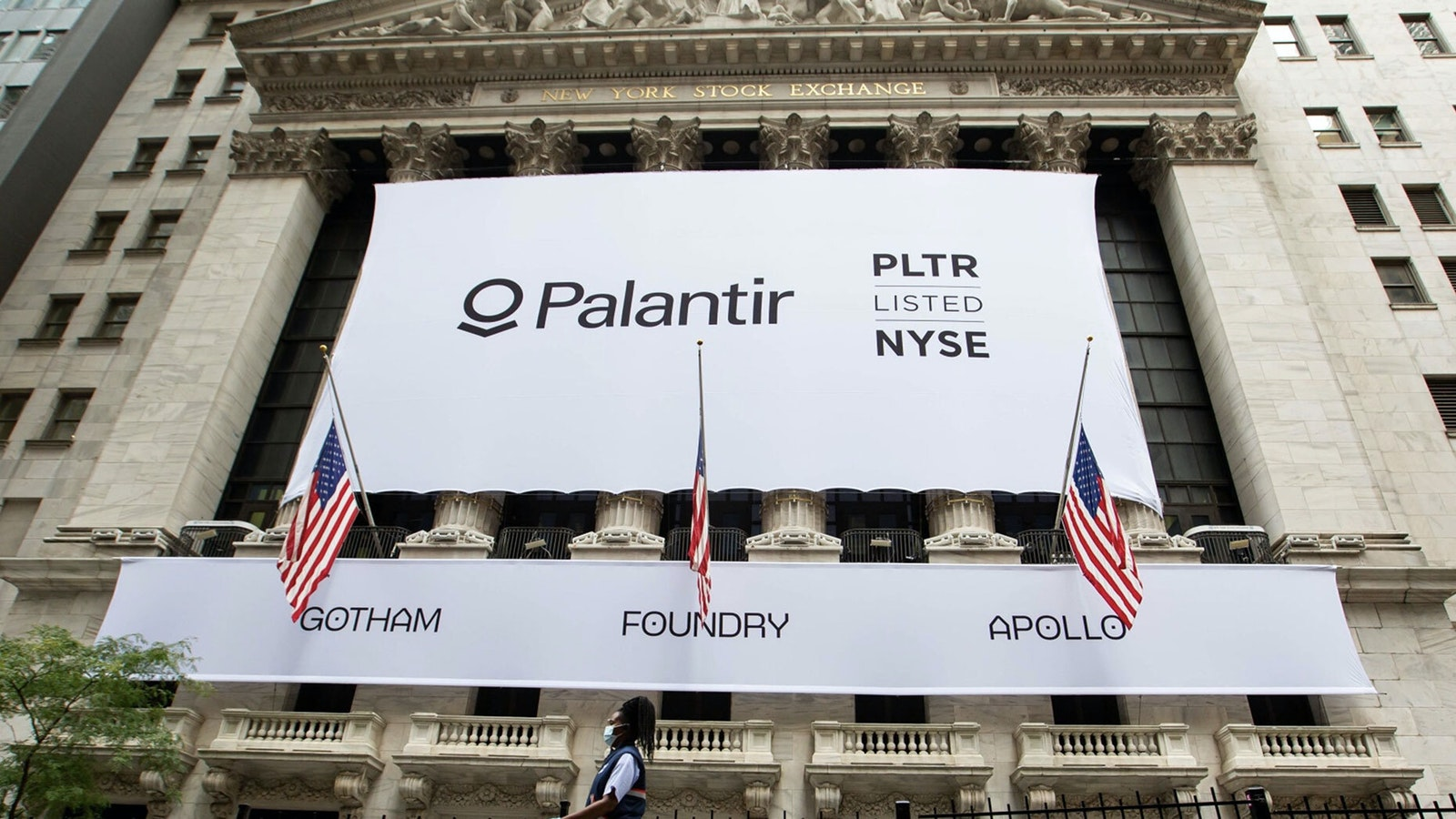 Palantir's sign hangs from the front of the New York Stock Exchange today. Photo by Bloomberg
