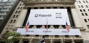 Palantir signage covering the New York Stock Exchange when the company went public last month. Photo by Bloomberg