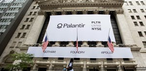 A sign for Palantir hangs over the New York Stock Exchange on the day it went public last month. Photo by Bloomberg.