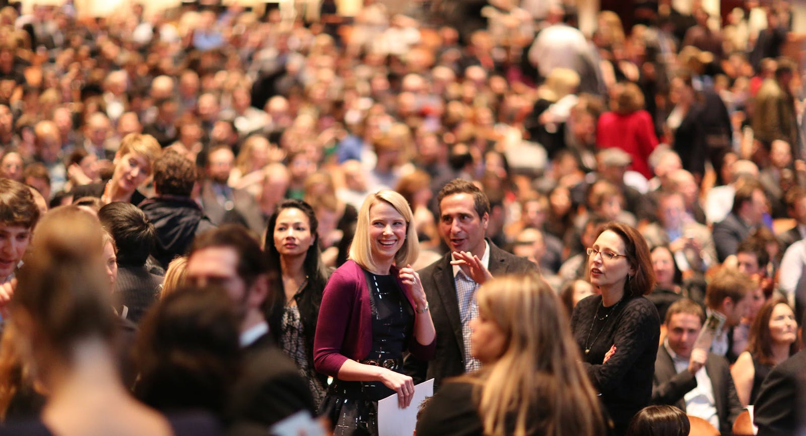 Marissa Mayer, CEO of Yahoo, with colleagues earlier this year. Photo by Max Morse.