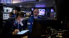 Traders on the floor of the New York Stock Exchange in March. Photo by Bloomberg