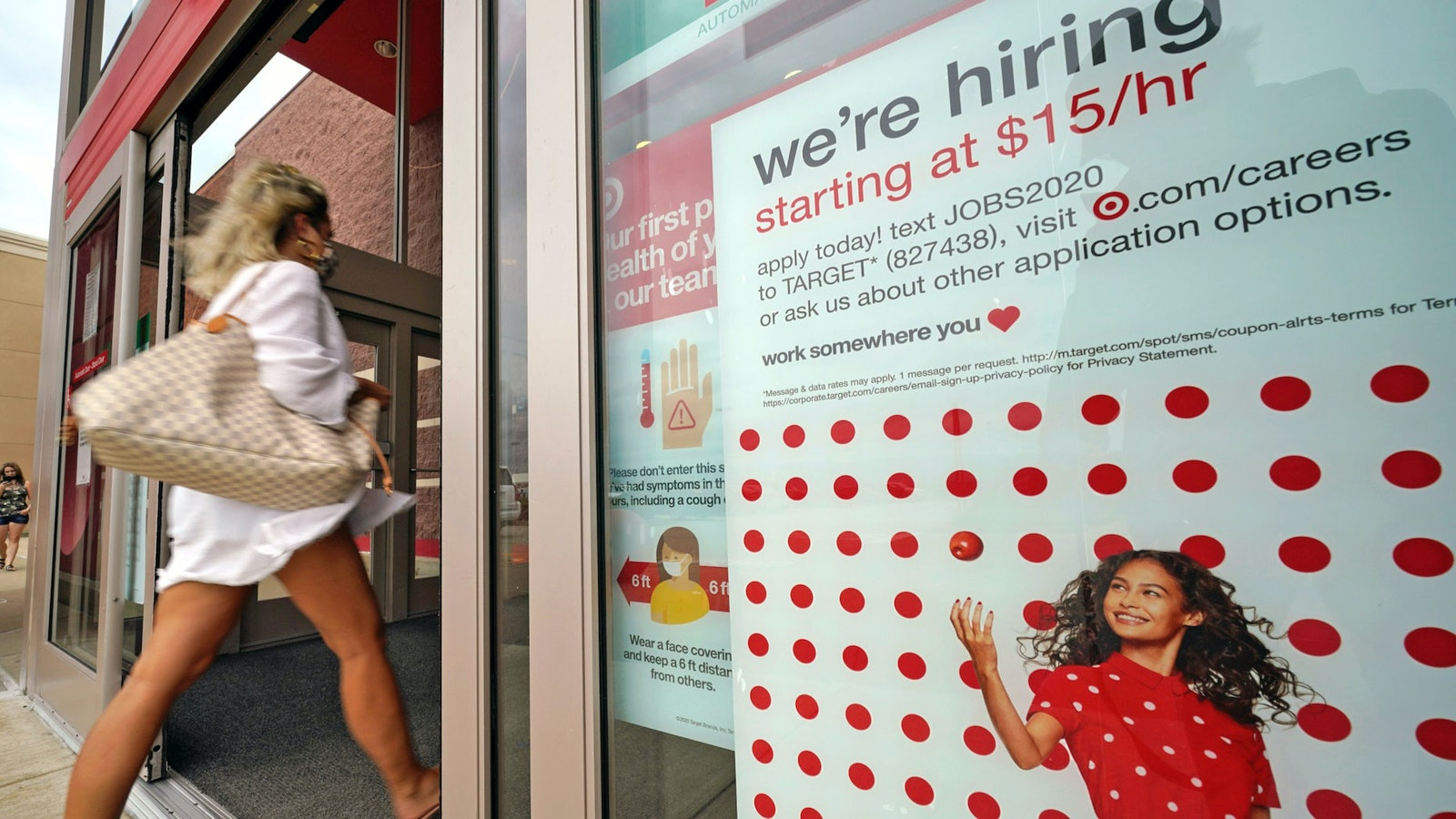 A help wanted sign hangs on the door of a Target store in Uniontown, Pa. Photo: AP